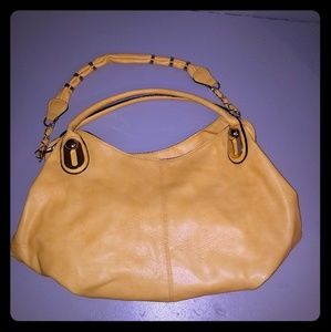 Handbags - Yellow leather purse.  Has no designer mark